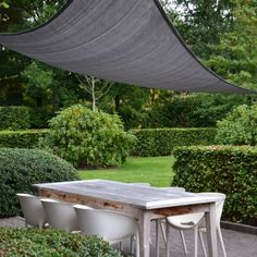 Interesting alternative to a shade tree, pergola or other shade structure for an outdoor dinning area.