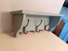 Painted pine coat rack with shelf and Victorian cast iron coat hooks