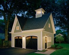 Stand alone carriage house in Concord, MA with cedar clapboard siding and 2nd floor storage