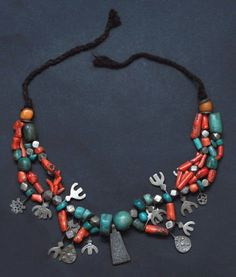 Morocco | Necklace from the Draa Valley region | Silver, turquoise, coral, amber, strung on a braid cord | Est. 600-800€ (Feb '14)