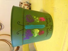 99 cent flower pot & acrylic paint foot print butterfly.  Cheap Mother's Day gift.