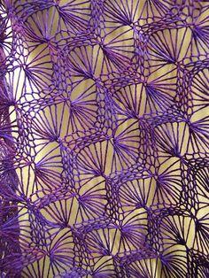 http://www.ravelry.com/patterns/library/machine-fan-lace-shawl FREE!!!