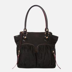 The new Jane Tote is styled after the best-selling Jane, but offers the ease of a snap-closure center compartment and two zip pockets at the top. Like the Jane, it's an ultimate everyday bag that will take you from work to dinner to weekend, season after season. Features rolled Italian leather handles with a shoulder length drop. Pictured in our classic black Bedford Nylon, with custom MZ Wallace gold hardware and finished with our signature red edge-dye, perfect for year-round wear.