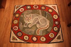 """Remake of a c.1918 hooked rug. Just love the cat encircled in the """"cat's paw design""""!"""
