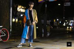 Streestyle of Yun Shen wearing a Outlaw Louis Vuitton, Fendi cape during Amazone Fashion Week Tokyo Spring Summer 2017
