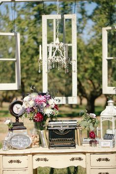 Guest Sign-in Tables | Vintage Wedding Decor |   Typewriter | Windows | Vintage Desk | Shabby-Chic Chandelier | Books | Chalkboard |  Photo By: KoriandJared.com