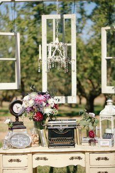 Guest Sign-in Tables | Vintage Wedding Decor | Typewriter | Windows | Vintage Desk | Shabby-Chic Chandelier | Books | Chalkboard | Photo By: KoriandJared.com