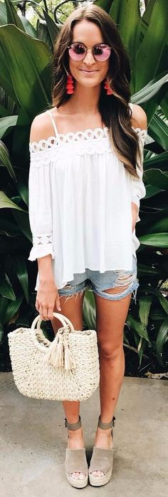 ripped shorts pairing with a white blouse