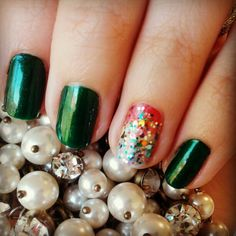 St. Patrick's Day nails - Emerald with a double rainbow accent.