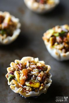 Baklava Cups--  Ingredients  1 (15-count) package mini phyllo cups 1 cup chopped nuts (pistachios, walnuts, almonds, pecans, or I used a mixture) 1 Tbsp. butter, melted 1/4 cup honey, plus more for serving 1/4 tsp. ground cinnamon pinch of salt.