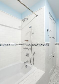 character picture rail height change from tile to paint then half height away from shower reminiscent of wood cladding