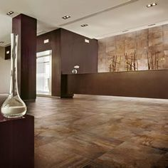 Floor features Vesale Stone 20 x 20 in color Rust from South Cypress. #entry #way #tile #stone #design #inspiration