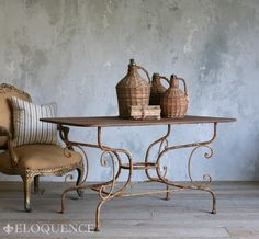 Eloquence, Inc. TDRC08-RS Sur La Sorgue Table Eloquence Sur La Sorgue table in iron with beautiful curving lines and aged and pitted rust-brown patina. A fantastic piece with a rustic French look. Two available.   29H x 60W x 30D
