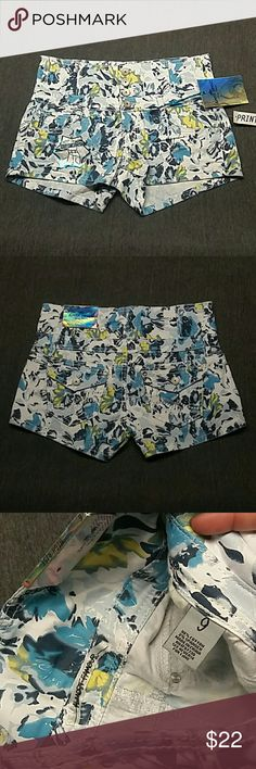 {3F20} High rise floral shorts Size 9, nwt. Waist 15, inseam 2 1/2. Please use the offer button if interested. *ship same/next day *no holds/trades *pet free *smoke free home Almost Famous Shorts Jean Shorts