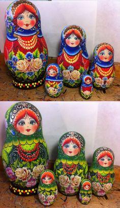 Colourful matryoshka dolls handpainted by artist Nelly Marchenko