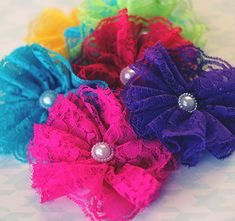 The Vintage Lace Flower Clip has the same flower from our popular headband, but with a convenient alligator clip backing! These hair clips are the perfect complement to a shabby chic look or one of our rompers or pettiskirts. They are made from the same lace as our petti rompers, petti dresses, and other lace petti products, so they will match perfectly! The flowers are about 3.5