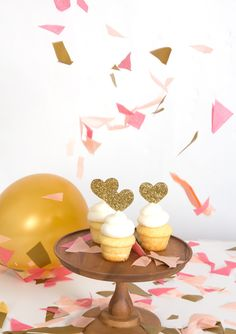 "Heart cupcake toppers for your treats and cupcake decorations. Our heart cupcake topper comes in poppy or gold hearts. Perfect for all treats, food, gifts, or with flowers. - 1.4"" wide, 2"" Tall - Made"