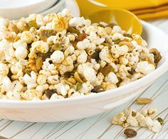 Pumpkin Patch Snack Mix: Pumpkin seeds and popcorn get jazzed up with your choice of cereal, pretzels, candy corn or corn nuts for this easy snack mix. Recipe and more Halloween ideas: http://www.midwestliving.com/food/holiday/13-great-halloween-treat-recipes/page/11/0