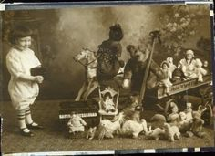 c. 1920's Great Photo of Grinning Kid with Camera Takes Pic of Toys, Wagon Full of Dolls, Black Doll on Horse