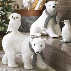 Create an instantly magical scene with this charming and delightful Sitting Polar Bear wearing a Scarf. This classic bear wears a coat of lightly glittered sisal fur and a gray knit scarf over a sculpted-foam base. He's irresistibly adorable and his pose makes him the perfect prop for the entryway or at the base of your Christmas tree. Pair him up with his Walking Polar Bear friend, sprinkle in some faux snow, and you'll have a wintertime display that everyone will rememb...