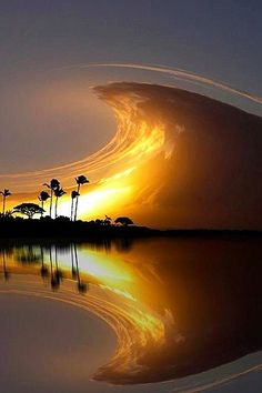 Original caption: Sky Wave, Costa Rica. Doc's Caption: a little smudge tool, a little blur tool...next thing you know you have a wave in the sky!! Amazing nature photo(shop)