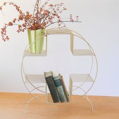 Classic mid century wire stand in ivory.  Perfect as a plant stand works for books or other smalls as well.  Great round shape.  Light wear with