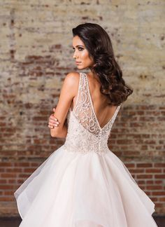 Look opulent in this ball gown with a Sabrina neckline, natural waistline, heavily adorned bodice, illusion V-back, and dreamy layered skirt with horsehair trim. https://www.justinalexanderbridal.com/signature_wedding_dresses/9847