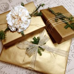 Matte gold kraft paper and neutral ribbons provide a contrast to evergreen trimmings for elegantly simple Christmas gifts. ☆ #GiftWrapping Design by The #PresentPixie {Raleigh, NC}