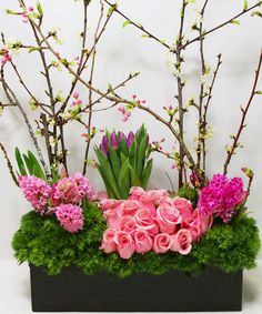 A Beautiful New Day-Blooming branches of Cherry Blossoms spring forth from a bed of mossy green Dianthus, adorned with Hyacinth, Tulips, and Roses, arranged in a rustic wooden box. A perfect way to celebrate the coming of the Spring. #Easter #EasterFlowers #FrenchFlorist #LosAngelesFlowers