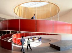"""Using red to create an impact. The designer's brief was to create an """"eye-catching, functional ramp structure … while avoiding an """"institutional"""" appearance""""."""