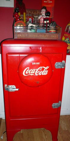 vintage Drink Coa Cola button sign on old red cooler/fridge