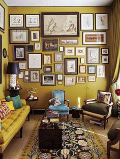 Contemporary Living Room with Massoud Cantrell Leather Chair, Anthropologie Atelier Chesterfield Sofa, Gallery wall, Carpet