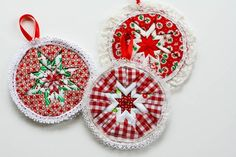 Ornaments made primarily from folded 2.5 inch squares of fabric. i could see these in other colours for other events as well as these in Christmas colours.
