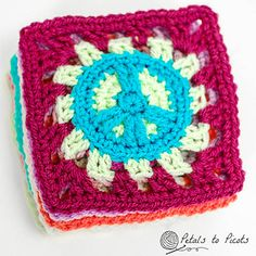If you have a tween or teen daughter, you probably know how popular peace signs are right now. So when my daughter asked me to make her an afghan, I wanted to make her something really cool … peace sign granny squares!