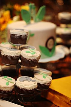 yellow sunflower safari baby shower with cupcakes topped with elephants