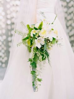 Modern Cascading Bouquet With White English Garden Roses, White Orchids, Lily Of The Valley, Fern, & Foliage****