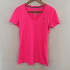 Nike Dri-Fit Top Nike Dri-Fit top. V neckline, fitted. Bright pink color. Has only been worn once, perfect condition!   ✨ 20% Bundle Discount  ✨ Accepting Reasonable Offers Nike Tops