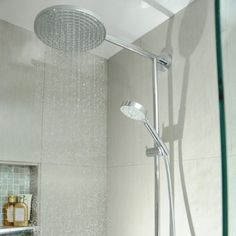 A picture of a wall-mounted rainfall showerhead