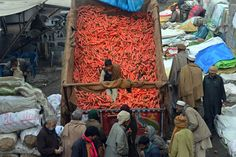 Arif Ali/Agence France-Presse/Getty Images SEEING ORANGE: A vendor sold carrots at a market in Lahore, Pakistan, Monday.