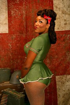 Black Pin-Up Girl, we don't see enough of these. ; ) ;)and she has a STUNNING skin tone, so caramel-y:P