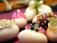 Needle crafted Jordan Almonds decorated with sequins and beads
