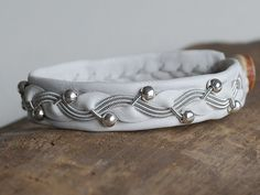 Items similar to Swedish Sami Bracelet of pewter thread with 4 % silver, and reindeer leather on Etsy Silver Beads, Silver Rings, Leather Design, Leather Working, Leather Craft, Pewter, Jewelry Design, Pearls, Handmade
