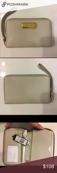 "‼️FIRM PRICE‼️MARC BY MARC JACOBS WRISTLET Marc by Marc Jacobs zip-around tumble weed beige leather wallet phone wristlet. Will fit iPhone 6, 6s , 7. Cash, card, coin , ID compartments. Gold tone hardware details. Measurements: 6.5""x4"". Marc by Marc Jacobs Bags Wallets"