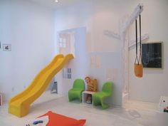 Slides in the house, what could be more fun than this? What a fun playroom?