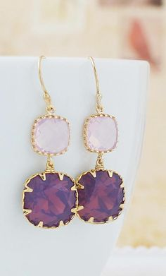 Purple earrings perfect for any wedding. Grab yours from Earrings Nation http://www.earringsnation.com/jewelry/bridesmaid-jewelry/cyclamen-opal-swarovski-crystal-with-violet-glass-dangle-earrings#.VHTITZPF8mx