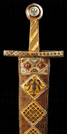 """""""The Ceremonial Sword"""" - Das Zeremonienschwert, made in Palermo before 1220. The sword pommel is a later edition, from the 3rd quarter of the 14th Century.   At the Kunsthistorisches Museum"""