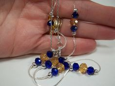 Blue and gold necklace from my #etsy shop: #Blueandgold #wvujewelry #mountaineerjewelry #westvirginiajewelry #jewelry #goldandblue #mountaineer #designsbydeirdreshop