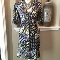 "A•B•S Collection Dress Beautiful dress in a leopard print by ABS. Fitted under the bust with beautiful knot detail. 94%rayon & 6%spandex, dry clean.  35"" from shoulder to hem, 24"" from empire waist to hem, 15"" across bust. New with tags. ABS Allen Schwartz Dresses Midi"