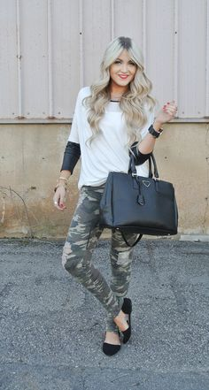 Long-sleeved shirt under short-sleeved sweater with Camo pants.