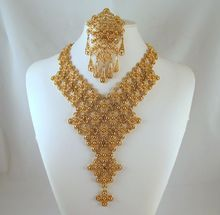 Monet Moresque Waterfall Bib Necklace Brooch Gold-tone from Grapenut Glitz Jewelry & Collectibles on Ruby Lane